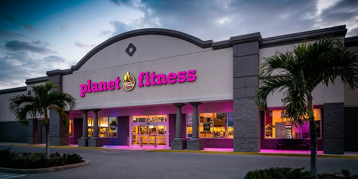 Planet Fitness gym exterior with purple/pink signs.