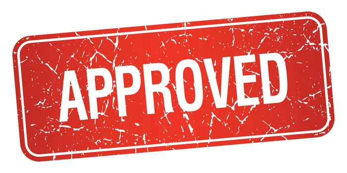 red stamp that says approved