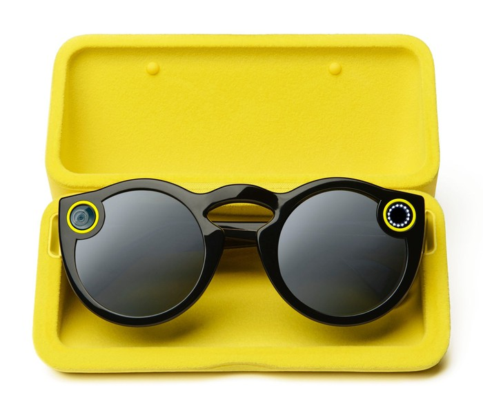 Snap camera spectacles in a yellow case.