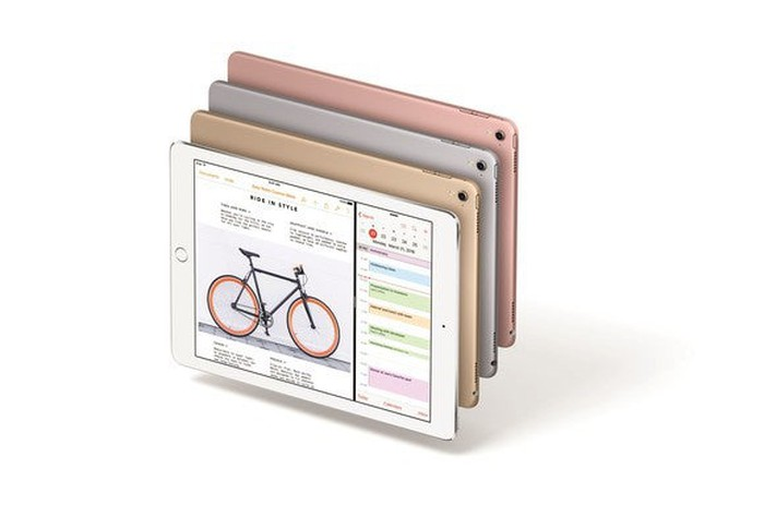 Apple's 9.7-inch iPad Pro tablets in silver, gold, gray, and rose gold.