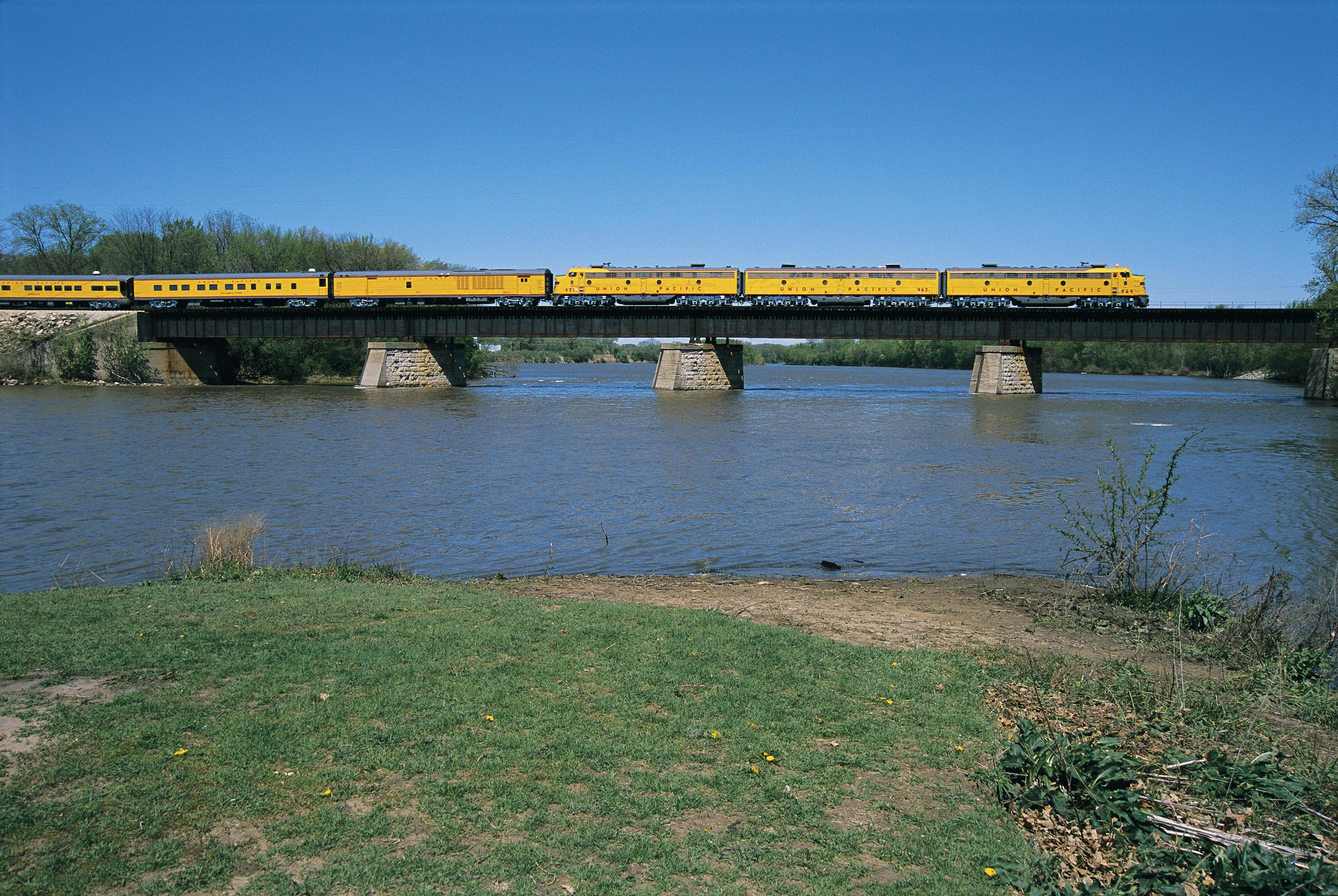 A Union Pacific train crossing a bridge over a body of water.