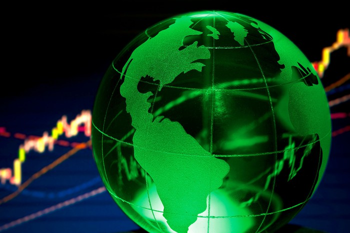 Green globe with stock chart in background