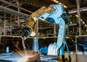 Getty Welding Robots in Factory