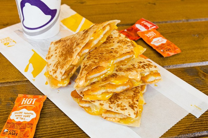 A chicken quesadilla piled up in quarters