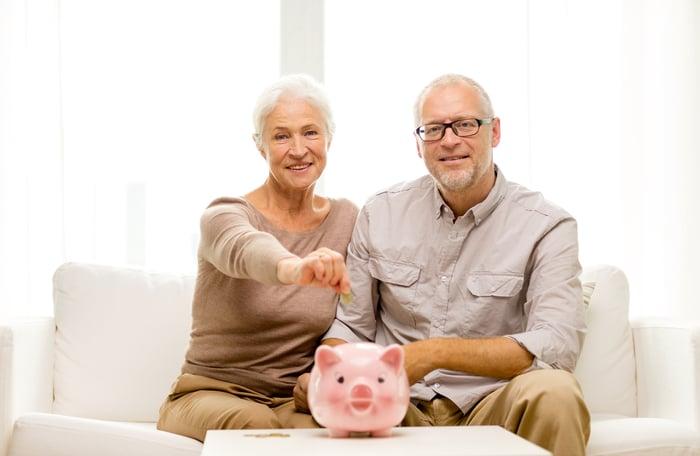 Senior couple with piggy bank
