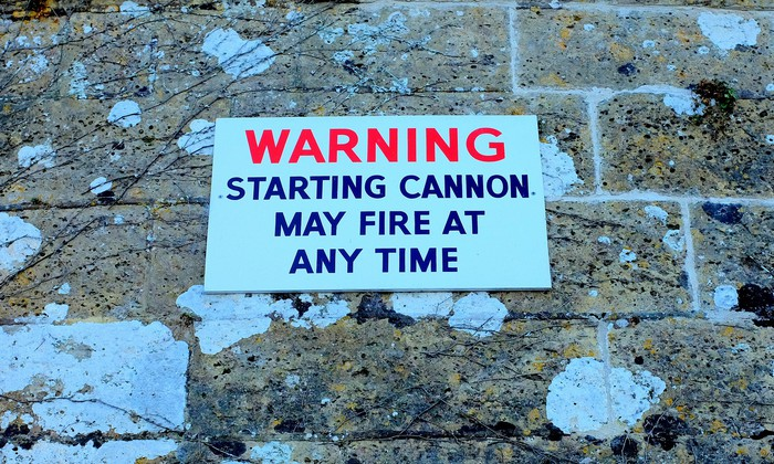 A sign that reads warning, starting cannon may fire at any time