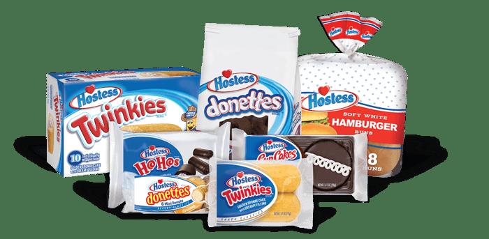 Various Hostess products including Twinkies, Donettes, hamburger buns, and HoHos