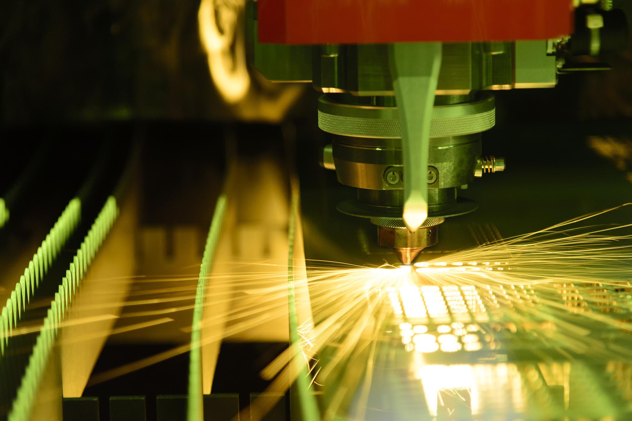 A fiber laser cutting through sheet steel.