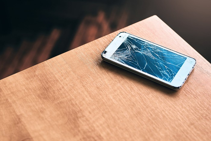 Broken smartphone on a table.