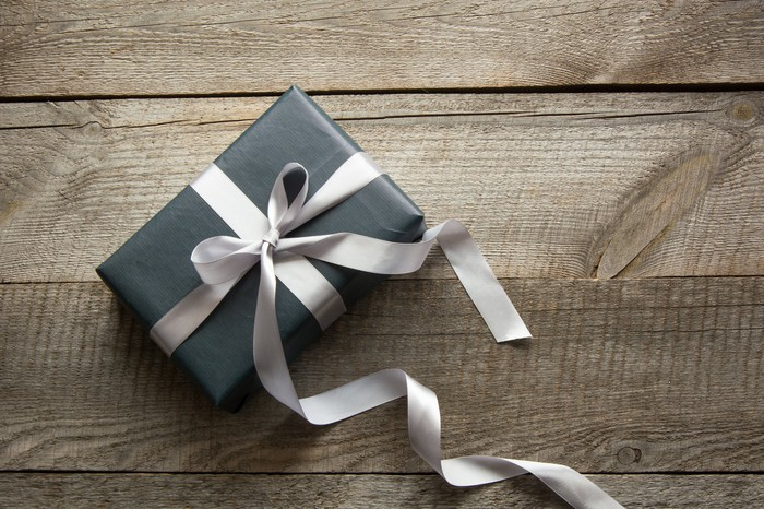 A gift-wrapped gift-card-sized box