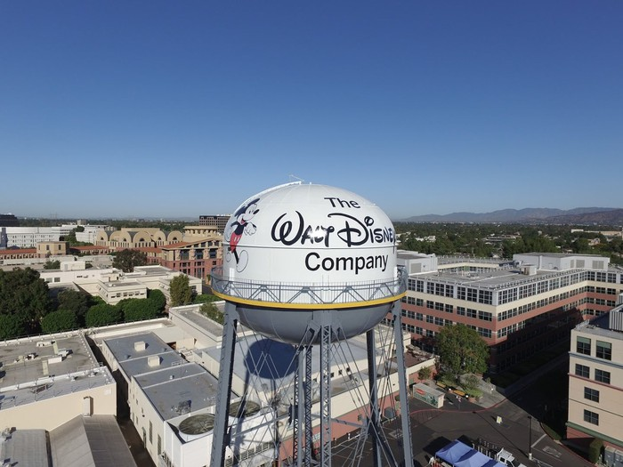 A water tower with The Walt Disney Company and Mickey Mouse painted on it.