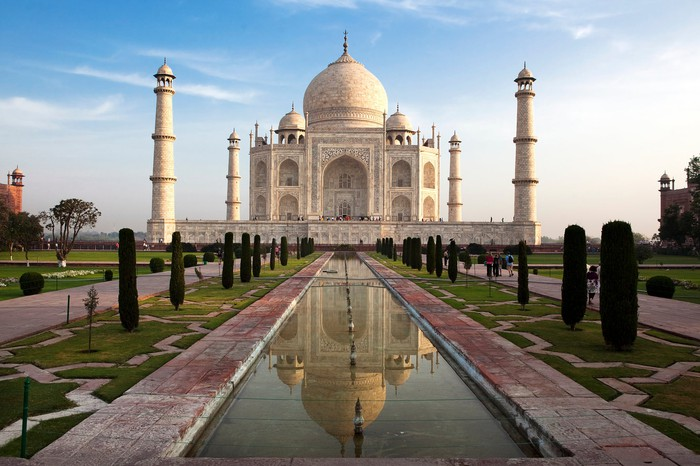 The Taj Mahal in India, a white palace with bulb-shaped dome on top and four smaller spires at each corner.