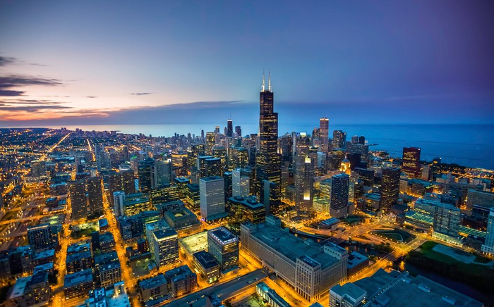 An aerial view of the Chicago skyline at dusk.