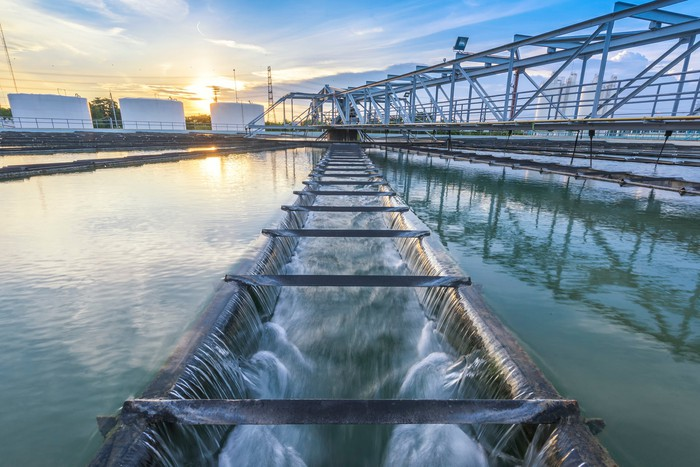 A water treatment plant at sunset.