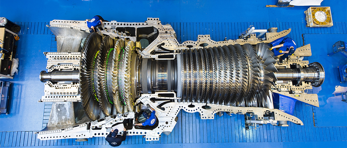 a GE gas turbine against a blue background