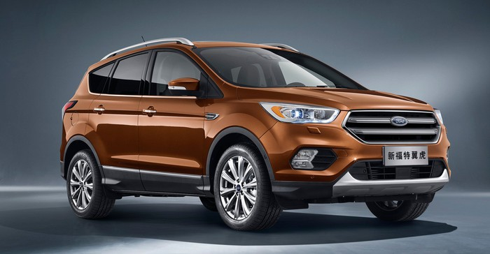 A brown 2017 Ford Kuga, a compact SUV, with Chinese license plates.
