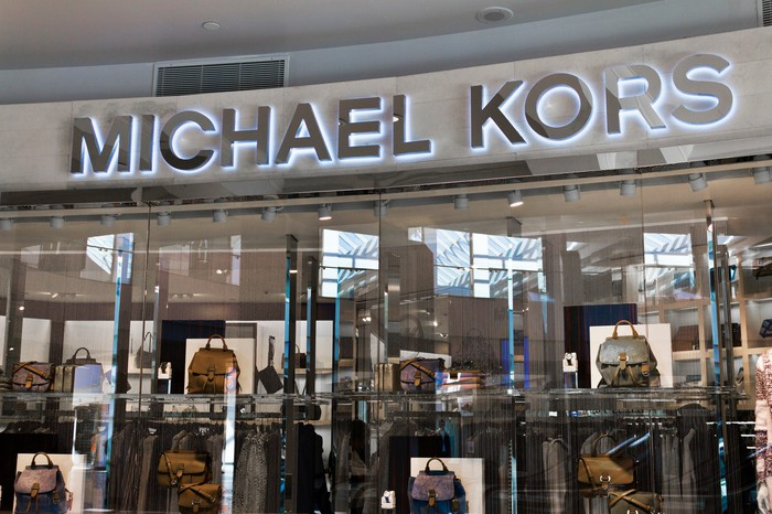 A Michael Kors storefront in a mall.