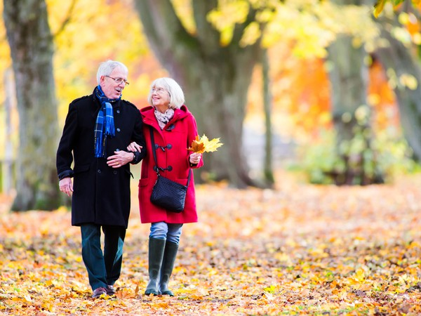 Senior Couple Enjoying Autumn Walk -- GettyImages-822500448