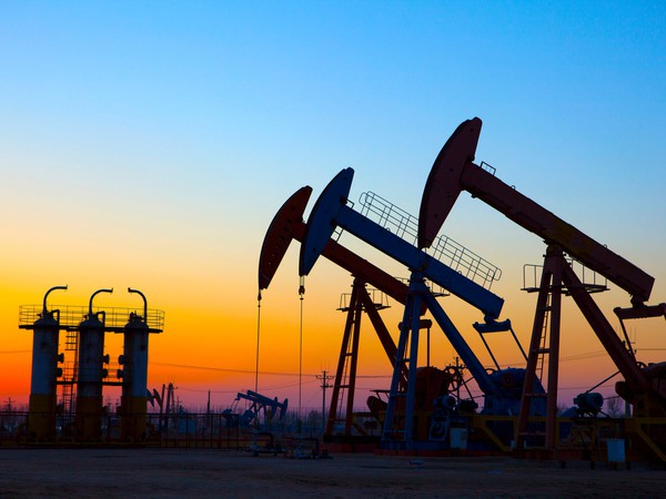Oil pumping Unit at sunset time