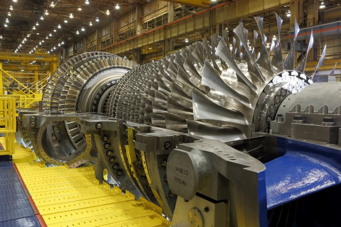 A gas turbine being built in a factory