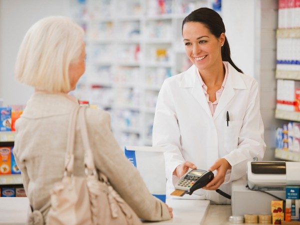 woman paying at pharmacy_GettyImages-107429877
