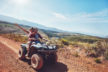 Couple Riding an ATV in the Mountains