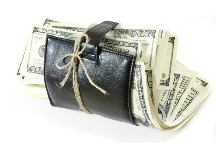 A leather wallet stuffed with hundred-dollar bills