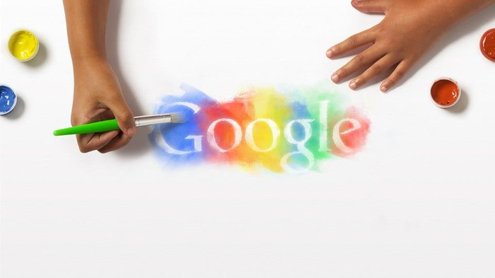 A person painting the Google logo.