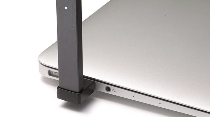 JUUL electronic cigarette plugged into USB port of laptop