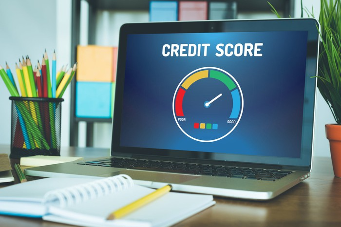 A computer with a graph indicating a good credit score.