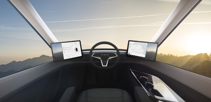 View from the interior of a Tesla Semi, showing driver seating in middle.
