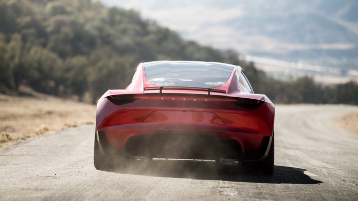 The back of a Tesla Roadster 2.0 while driving.