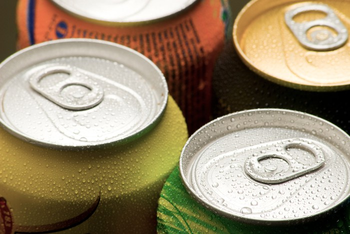 close-up on the tops of aluminum cans