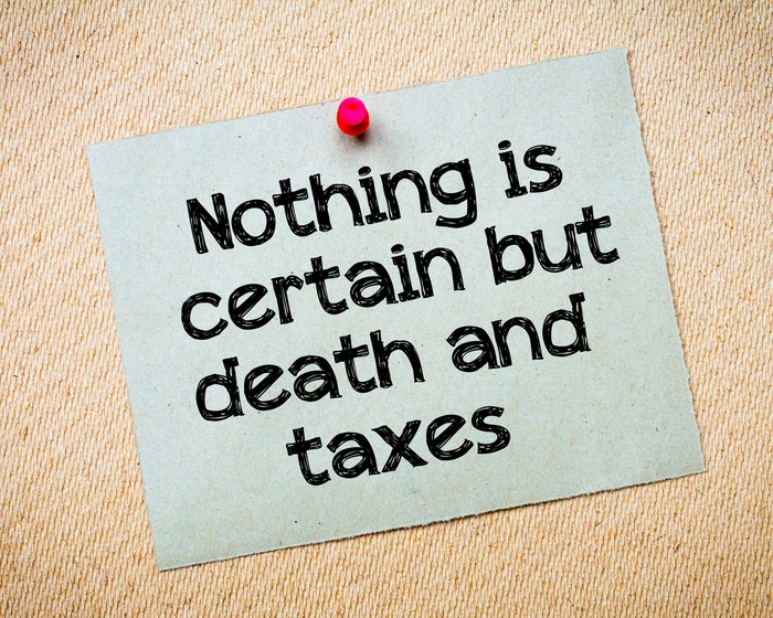 "Pinned notecard reading ""Nothing is certain but death and taxes"""
