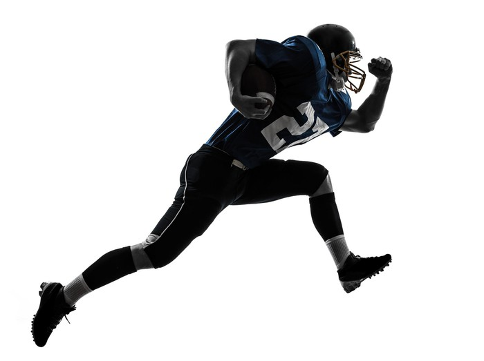 American football player in number 27 jersey running with the ball