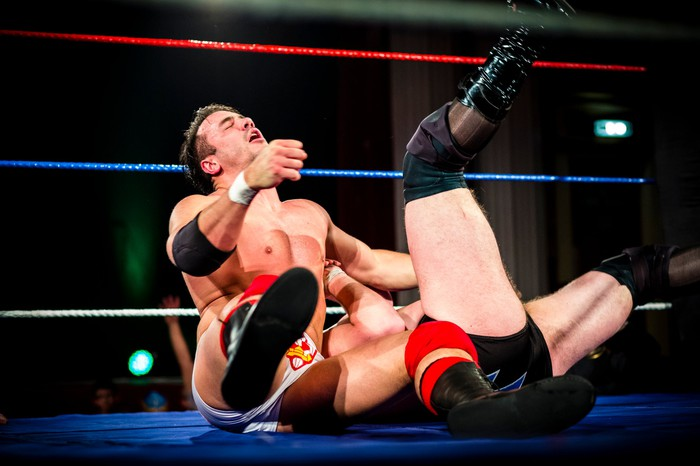 two pro wrestlers in wrestling ring