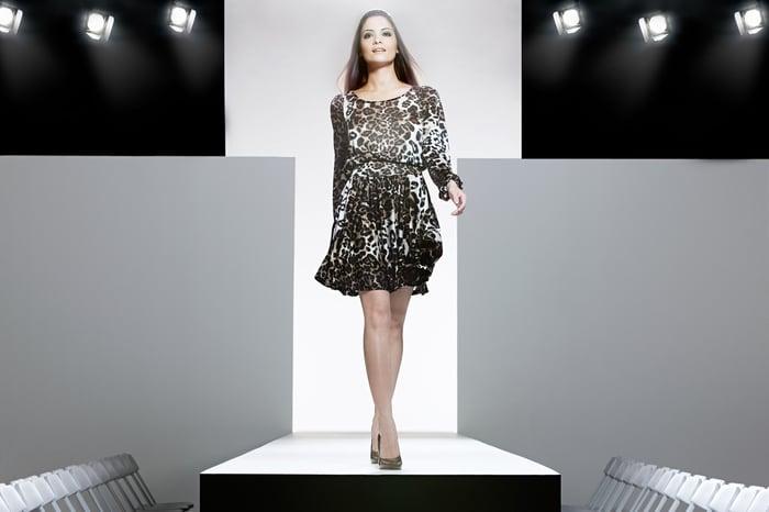 Model walking on a fashion runway.