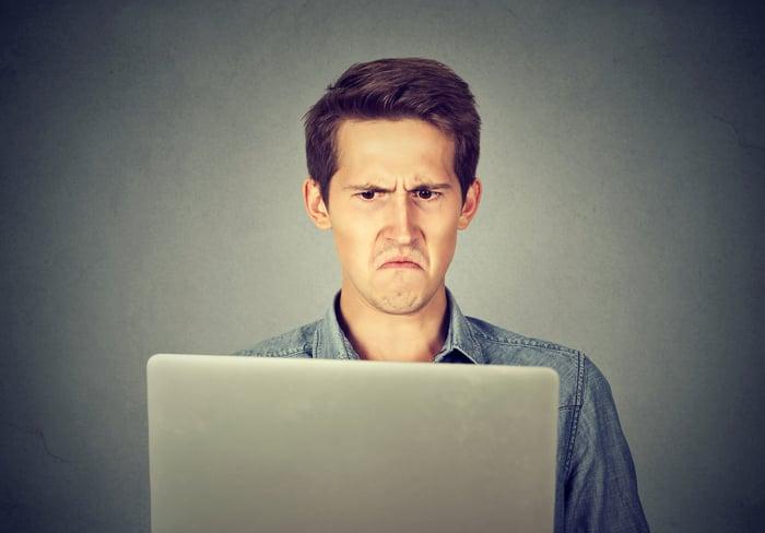 Man frowning at laptop