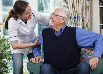 Assisted living worker with older man