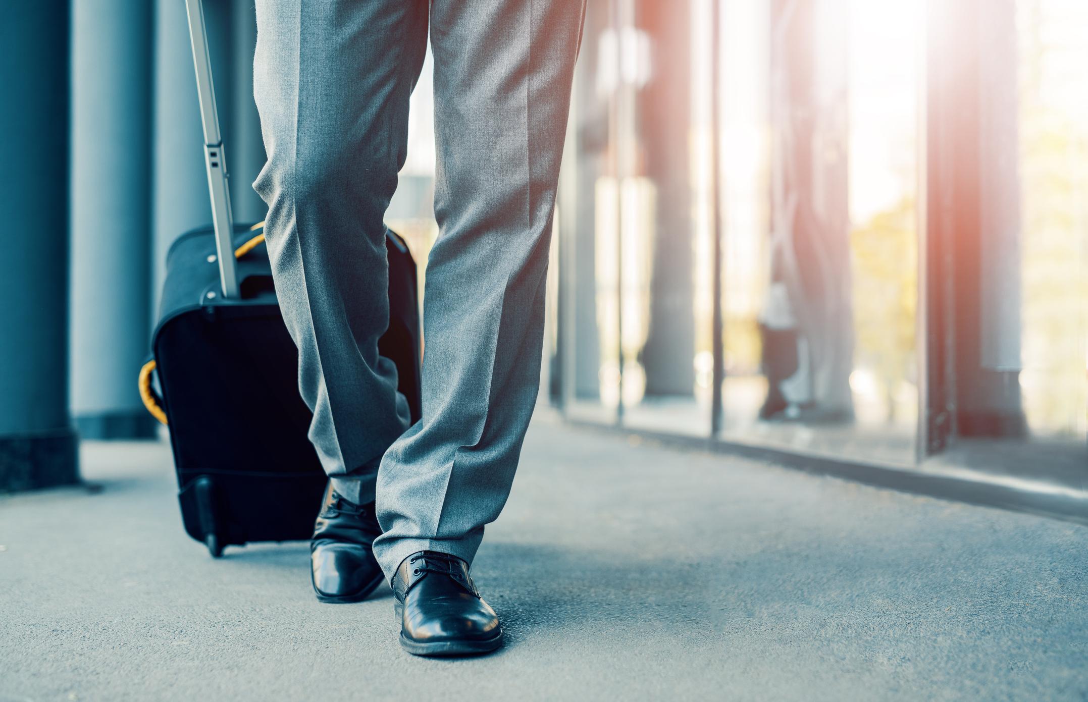 Man pulling suitcase