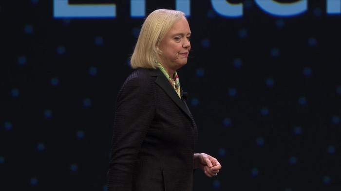 Meg Whitman on a stage under an Hewlett Packard Enterprise banner.