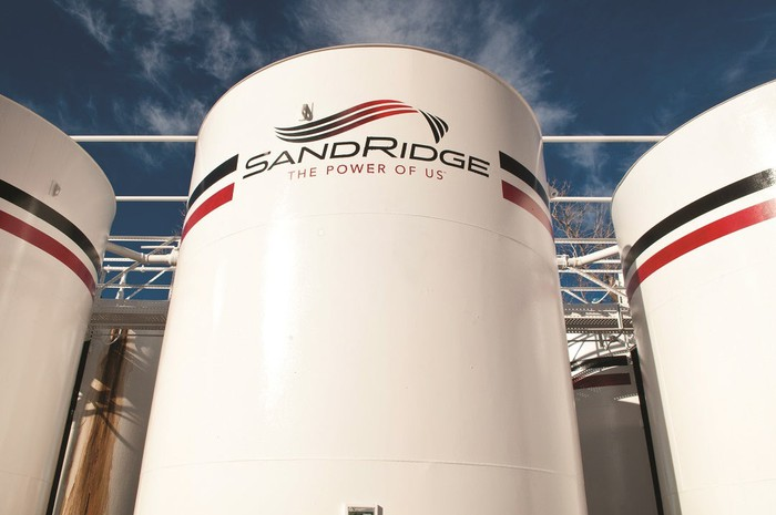 Large energy storage tanks with SandRidge logo on side.