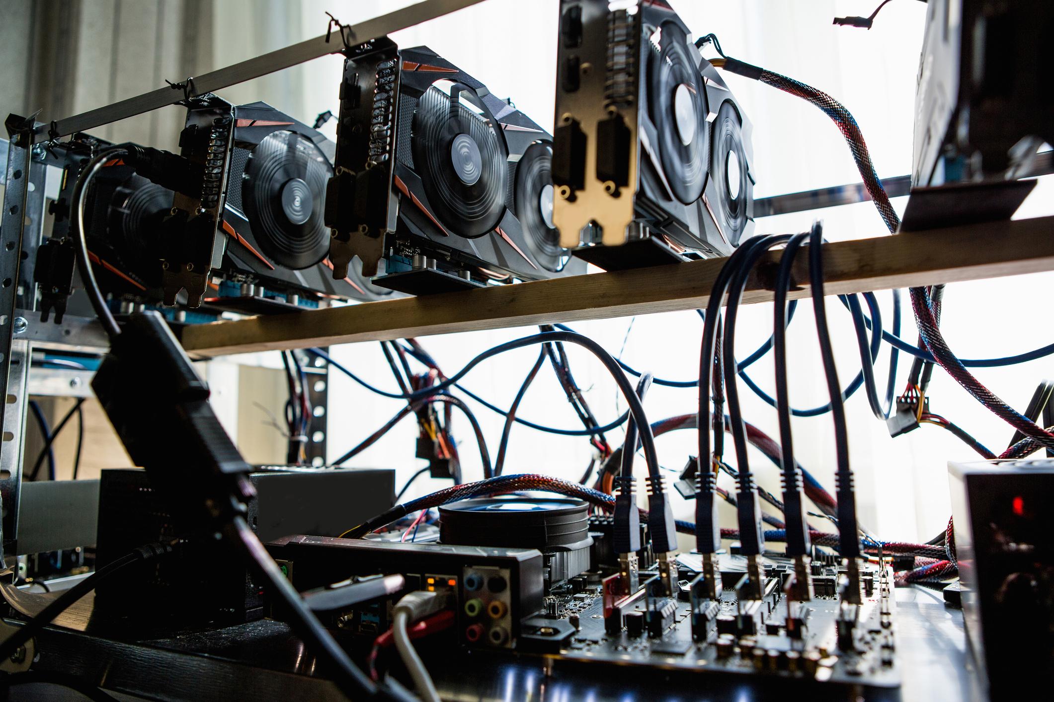 Hard drives set up on a shelf.