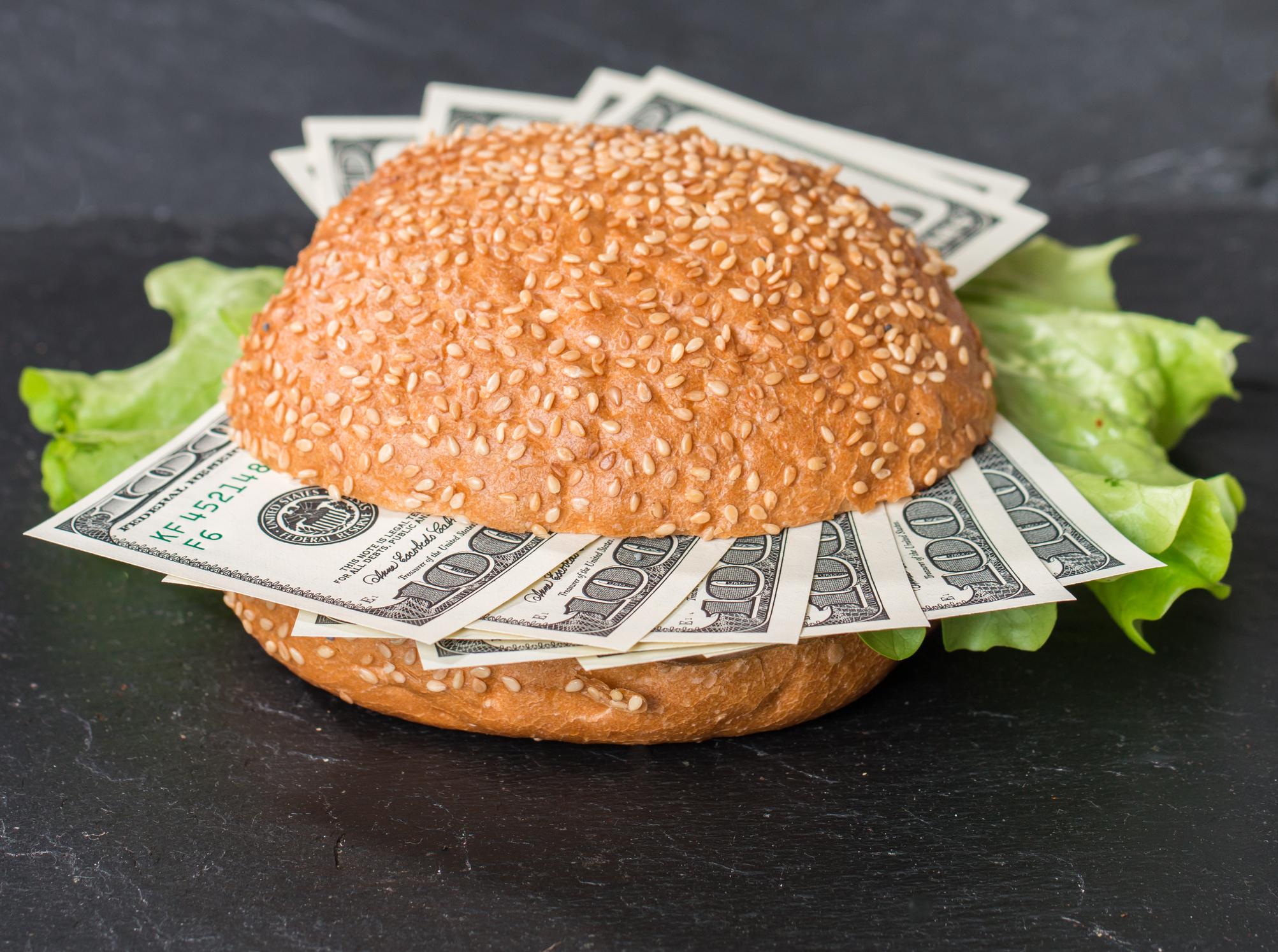 Burger bun with $100 bills instead of meat