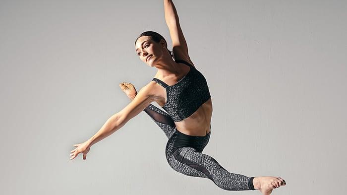 Ballet dancer practicing while wearing Lululemon apparel.