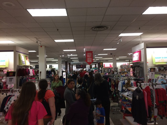 Customers waiting on a long checkout line at the J.C. Penney store in the Sunrise Mall
