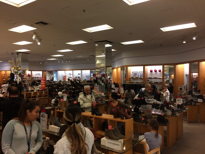 Customers shopping in the Macy's shoe department at the Arden Fair Mall