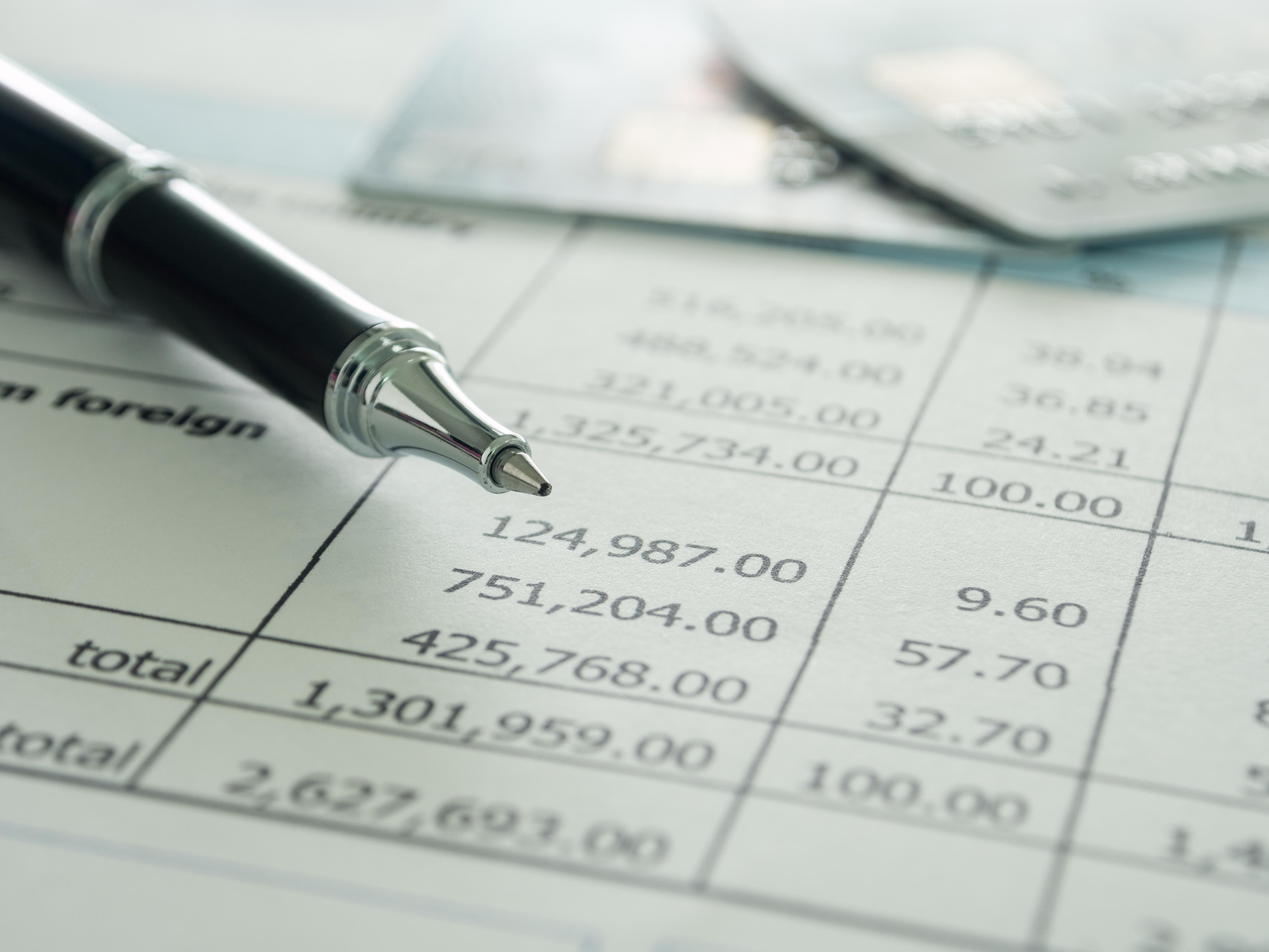 Ballpoint pen and financial statement