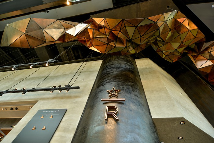 The Starbucks store in Hong Kong features geometric art hanging from the ceiling