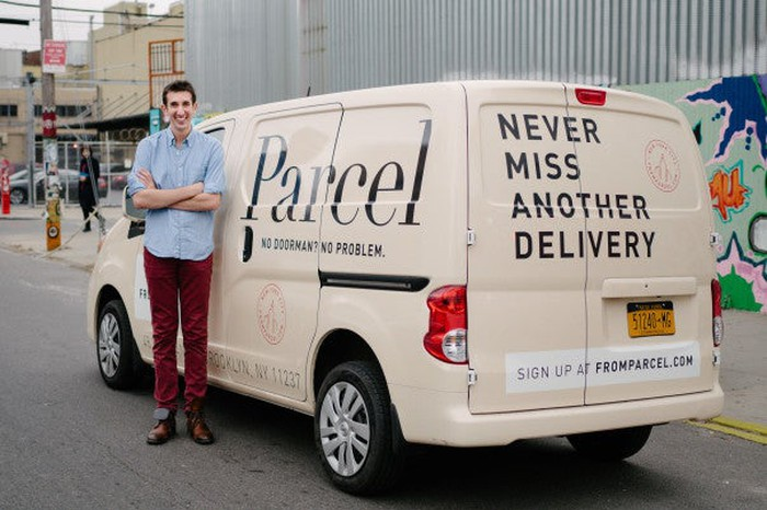 Parcel founder Jesse Kaplan stands in front of an off-white Parcel delivery van.